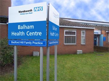 Image of the Balham Health Centre sign and building